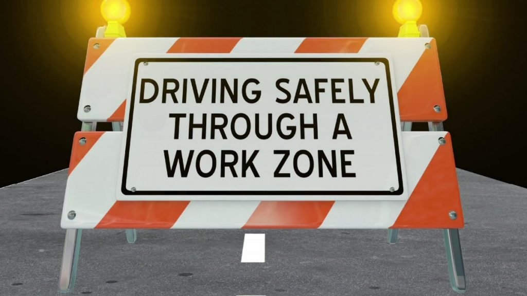 WATCH THE ROAD!!  DON'T DRIVE DISTRACTED!!  CONSTRUCTION ZONE AHEAD!